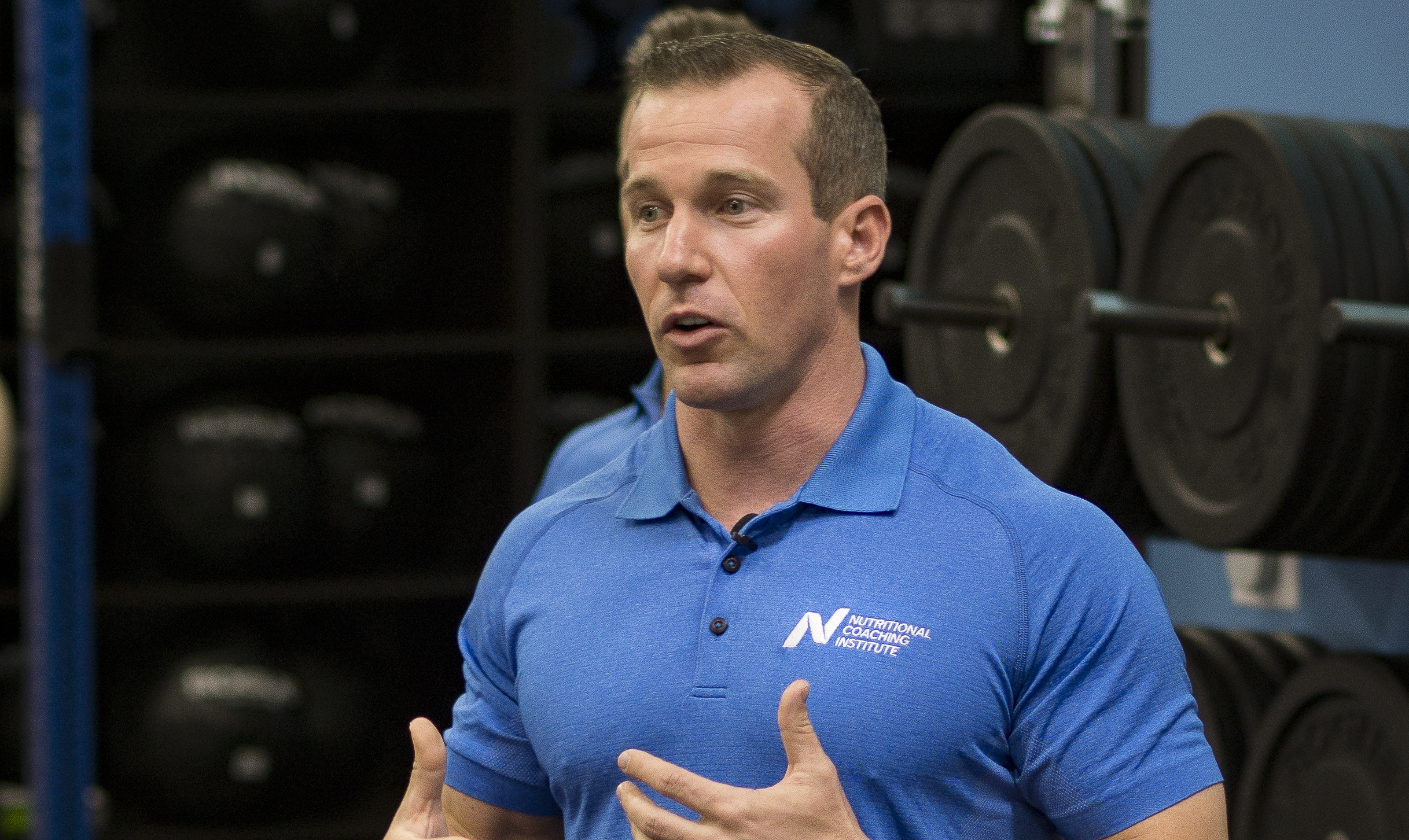 Jason Phillips teaching nutrition coach classes